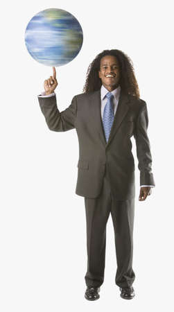 ethiopian ethnicity: Full view portrait of businessman twirling globe LANG_EVOIMAGES