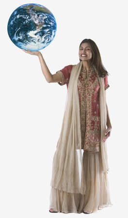 above 25: Full view portrait of woman holding globe