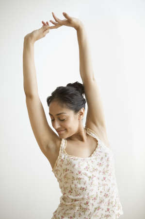 above 25: Young adult woman stretching