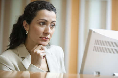 above 30: Businesswoman concentrating on computer