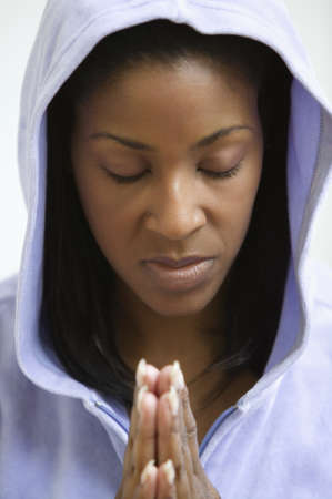 above 25: African American woman praying LANG_EVOIMAGES