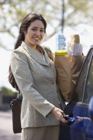 above 25: Portrait of woman holding groceries