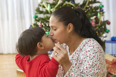 fond of children: Little boy kissing mom
