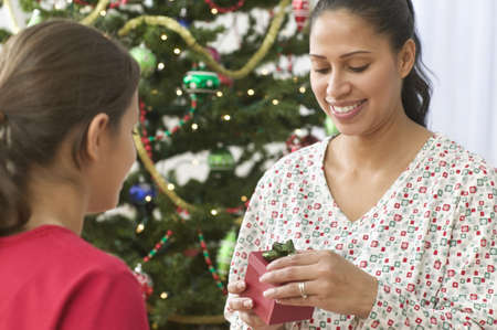 some under 18: Mother opening her daughterís gift on Christmas day