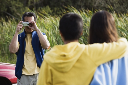 some under 18: Man taking picture of his family
