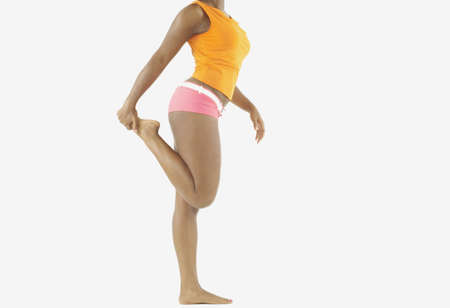 lower section view: Side view of lower section of woman stretching