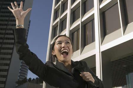 hailing: Businesswoman hailing cab