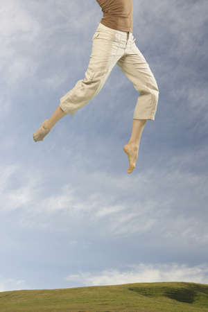 lower section: Lower section of woman jumping in air LANG_EVOIMAGES