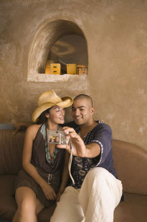 taking a wife: Couple taking self-portrait with camera LANG_EVOIMAGES