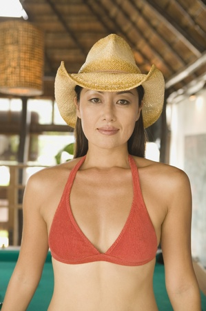 above 30: Portrait of woman in bikini top and cowboy hat
