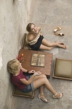 High angle view of two woman playing backgammon Stock Photo