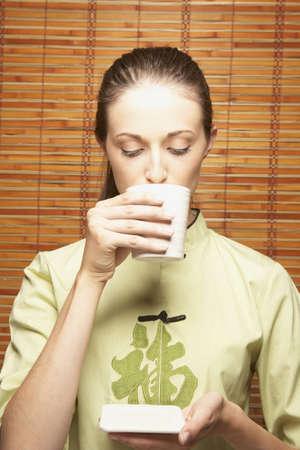 Woman drinking tea Stock Photo - 16043281