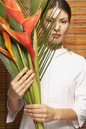 Portrait of woman holding bird of paradise Stock Photo - 16073113