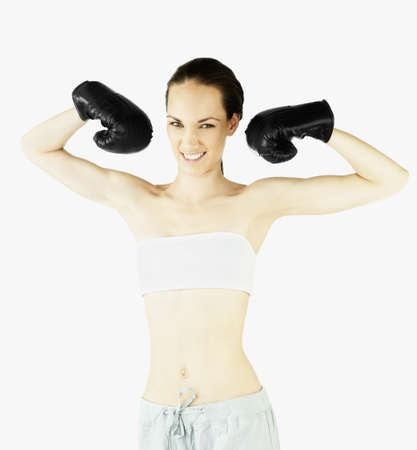 Female boxer flexing her muscles Stock Photo - 16073127