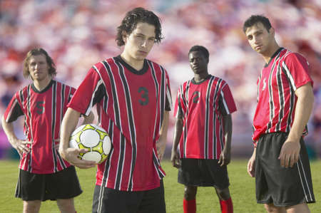 grandstand: Soccer players posing for the camera on pitch