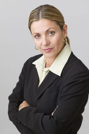 unyielding: Middle aged businesswoman posing for the camera with arms crossed