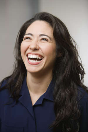 hilarity: Young woman laughing LANG_EVOIMAGES