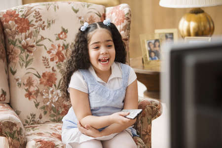 spectating: Young girl watching television