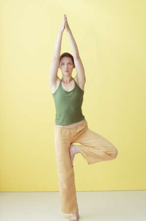 seriousness skill: Young woman practising yoga LANG_EVOIMAGES