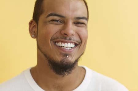 relishing: Young man laughing LANG_EVOIMAGES