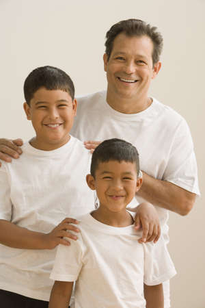 Father and sons posing for the camera Stock Photo - 16073250