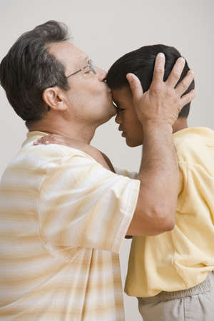 poppa: Father kissing sons forehead