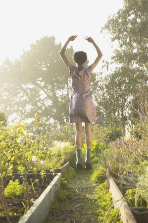 elation: Young woman gardening