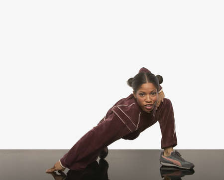 exerting: Young woman posing for the camera in a track suit LANG_EVOIMAGES