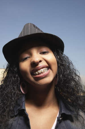 headgear: Teenage girl showing off her braces for the camera
