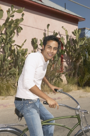 lighthearted: Young man riding a bicycle