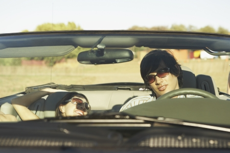 time drive: Couple driving a convertible