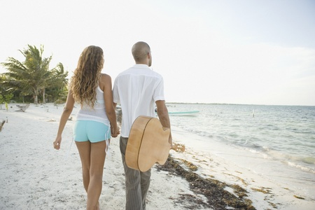 Young couple walking on the beach