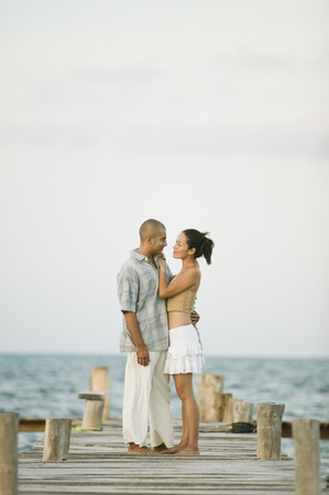 Couple hugging on a pier Stock Photo - 16073468