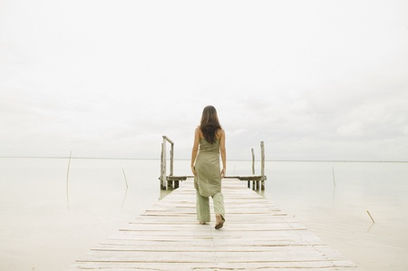 casualness: Woman walking down pier LANG_EVOIMAGES