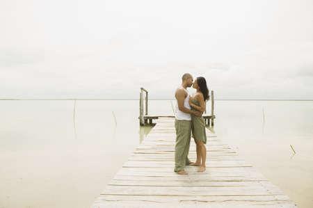 kisser: Couple kissing on a pier