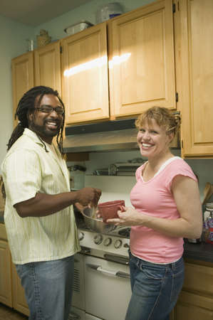 Couple cooking in the kitchen Stock Photo - 16073481