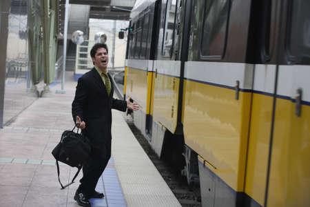 late 20s: Businessman shouting at a passing train