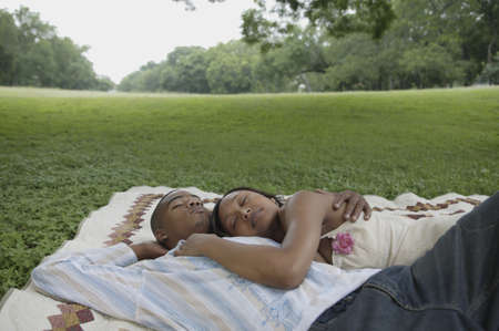 Couple relaxing on a picnic blanket outdoors Stock Photo - 16073505