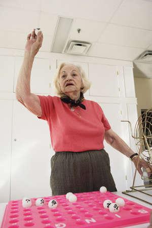 Elderly woman playing bingo Stock Photo - 16073516