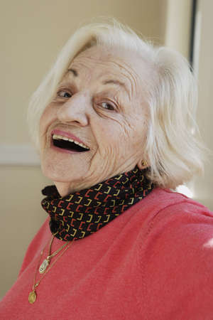 Elderly woman smiling for the camera Stock Photo