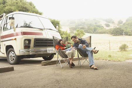 Family sitting by truck outdoors Stock Photo - 16073541