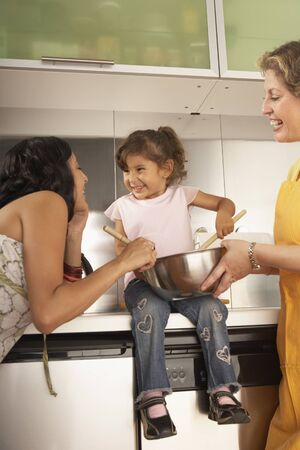 Female members of a family cooking together Stock Photo - 16073557