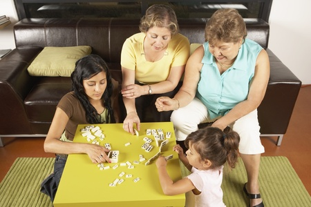Female members of a family playing dominoes Stock Photo - 16073564