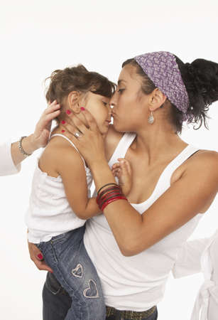 profile: Young woman kissing her daughter