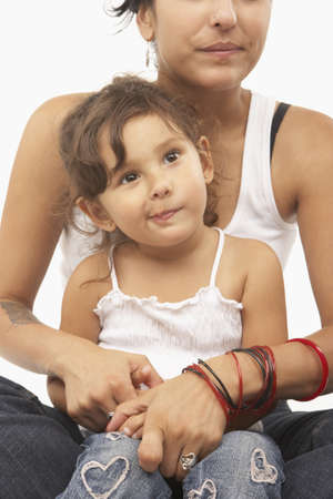 bracelet tattoo: Mother holding her daughter in her lap