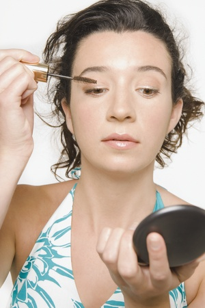 Young woman applying makeup Stock Photo - 16073585