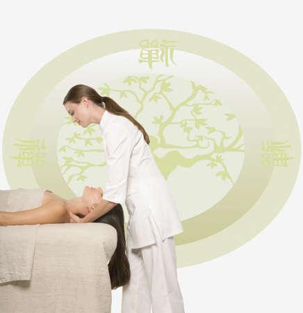Woman having a massage against Oriental background