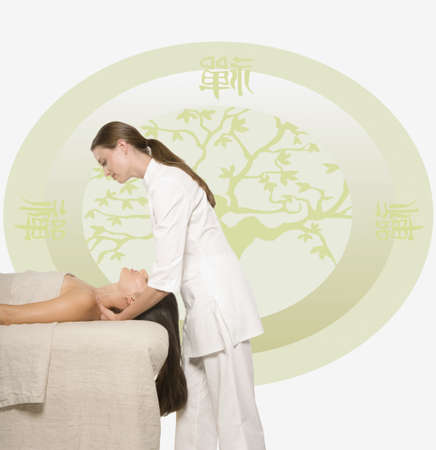 Woman having a massage against Oriental background Stock Photo - 16073594