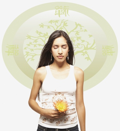 Young woman meditating with flower against Oriental background Stock Photo - 16073596