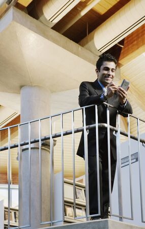 Male executive using PDA Stock Photo - 16073601
